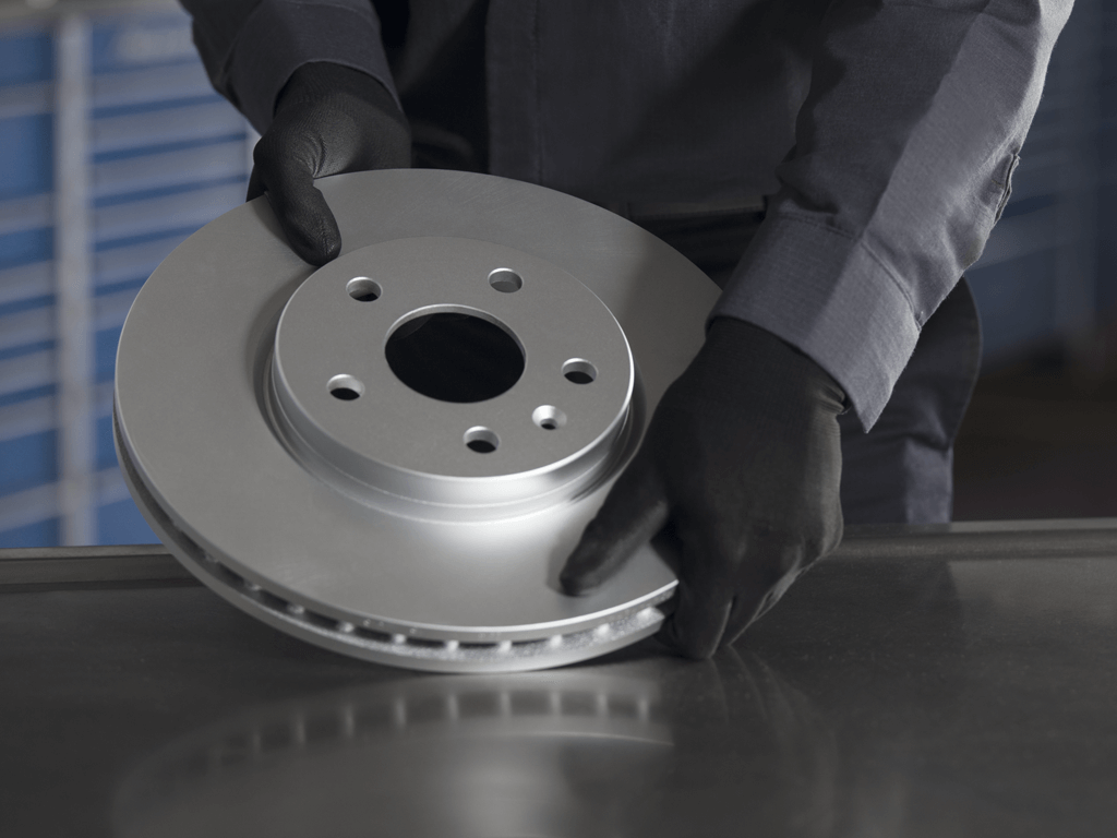 ACDelco Brake Rotor or Drum held by technician